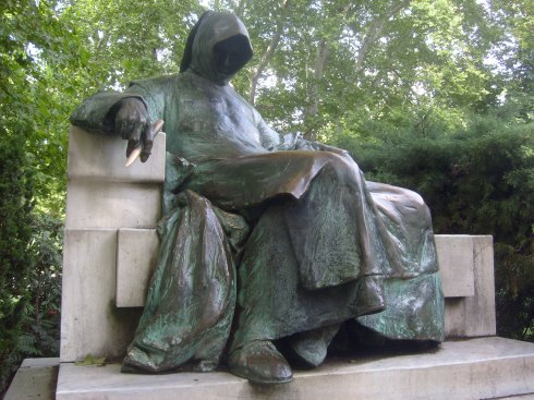 The 'Anonymous' statue in City Park, Budapest. Commemorating the unknown scribe who recorded the story of the Magyars. Rubbing his pen brings inspiration.